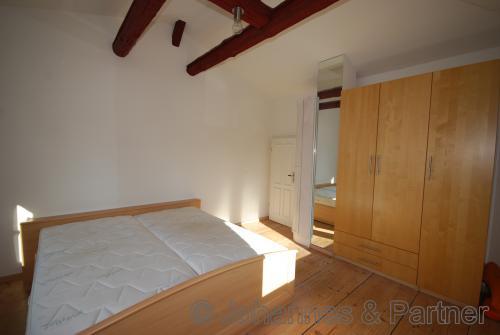 Schlafzimmer im Obergeschoss (auf Wunsch möbliert)