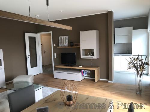 Wohnzimmer (Beispielfoto aus der Musterwohnung Striesen Plus I)