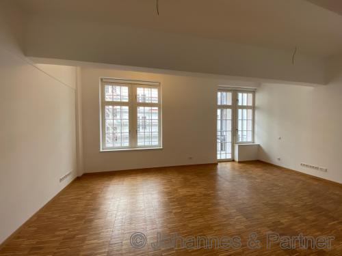 Wohnzimmer und Küche (Foto aus einer fertigen Wohnung im 1. BA)